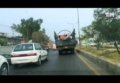 Guy Relaxes on Makeshift Hammock on Truck While it Moves on Road