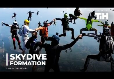 Skydivers Hold Hands to Make Upright Formation in the Sky